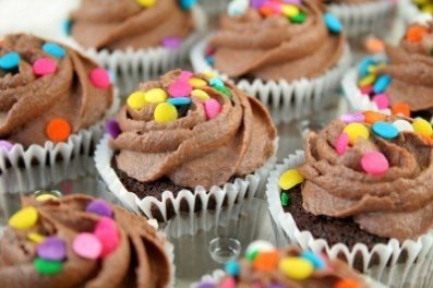 7504409-chocolate-cupcakes-with-colorful-sprinkles--used-a-shallow-dof-with-selective-focus